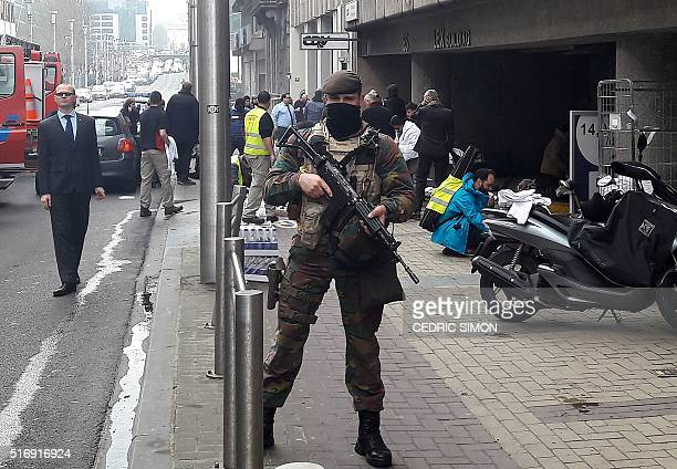 Belgian soldier stands guard outside the Maalbeek Maelbeek metro station in Brussels on March 22 2016 after a blast at this station located near the...
