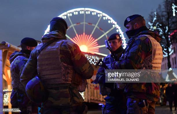Belgian soldiers patrol during the opening night of the annual Christmas market on November 27 2015 in Brussels Belgium reduced the terrorism alert...