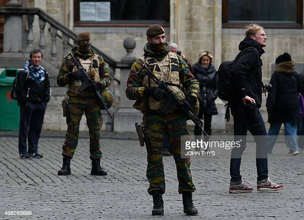 Belgian soldiers stand at the Grand Place in Brussels on November 22 2015 The Belgian capital was locked down for a second day on November 22 with...