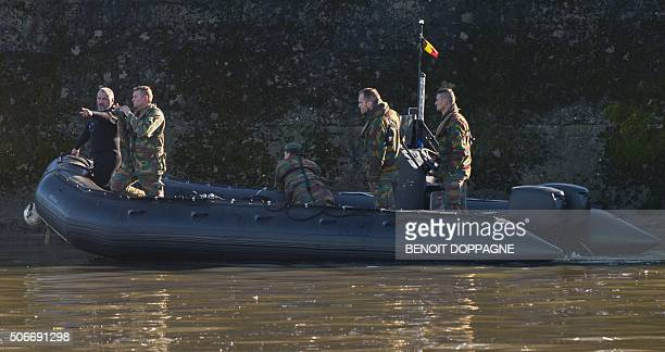 Belgian soldiers stand on a boat at the spot where the body of a 12yearold boy Antoine was found in the Meuse river in Huy on January 25 2016 The...