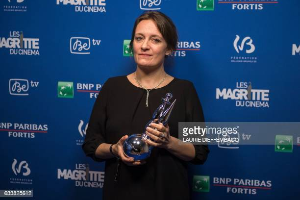 Belgian sound engineer Julie Brenta poses with an award during a photocall for the 7th edition of the Magritte du Cinema awards ceremony in Brussels...
