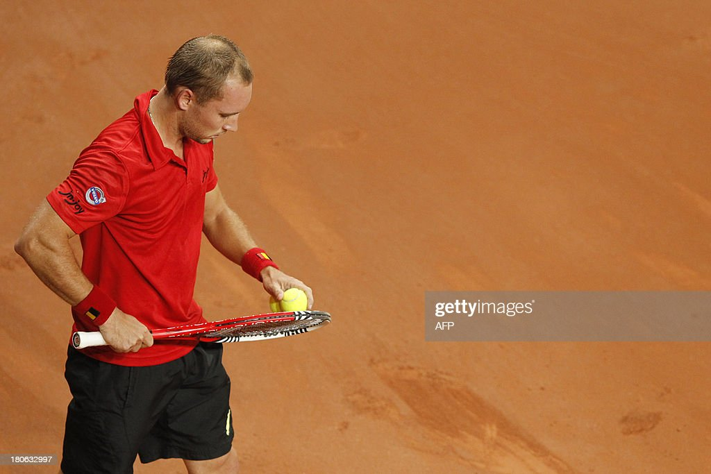Belgian Steve Darcis prepares to serve to Israeli Amir Weintraub on September 15, 2013 during a Davis Cup World Group play-off tennis match in Antwerp.