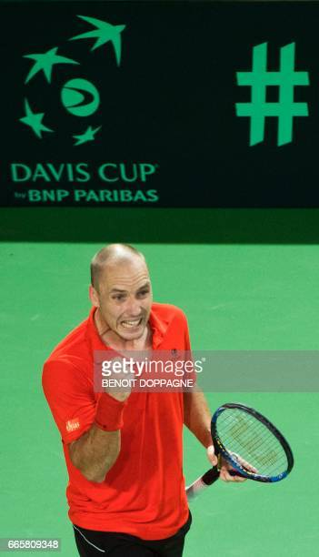 Belgian Steve Darcis reacts during his first match against Italian Paolo Lorenzi in the singles of the Davis Cup World Group quarterfinals match...