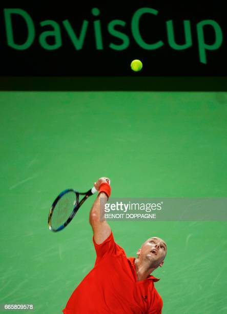 Belgian Steve Darcis serves to Italy's Paolo Lorenzi during their single match of the Davis Cup World Group quarterfinals between Belgium and Italy...