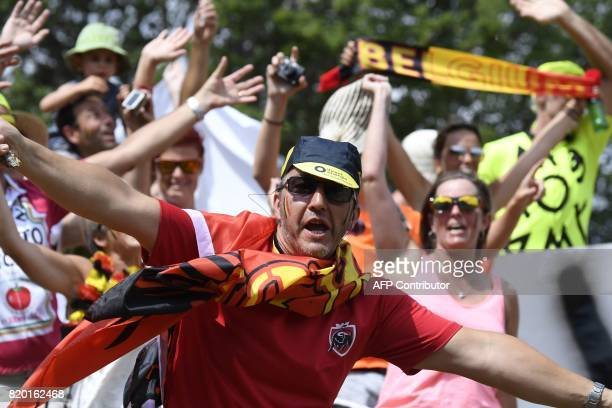 Belgian supporters cheer along the road during the 2225 km nineteenth stage of the 104th edition of the Tour de France cycling race on July 21 2017...