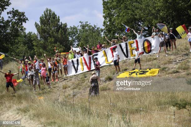 Belgian supporters cheer along the road with a banner reading 'Long life cycling' during the 2225 km nineteenth stage of the 104th edition of the...