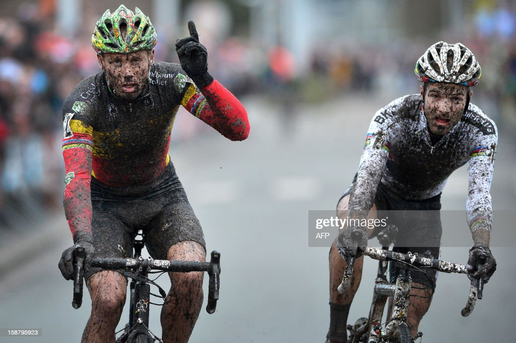 Belgian Sven Nys (L) celebrates victory as he crosses the finishing line ahead of Belgian Niels Albert at the end of the 'Versluys Ereprijs Paul Herygers' sprint cyclocross race in Bredene, on December 29, 2012. QFP