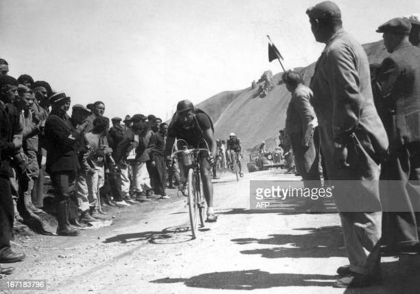 Belgian Sylvère Maes rides uphill in the Col de l'Izoard during the 9th stage of the Tour de France between Briançon and Digne on July 16 1936 Maes...