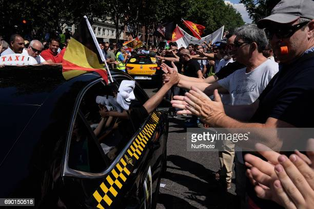 Belgian taxi drivers during a protest by a Spanish taxi drivers in Madrid