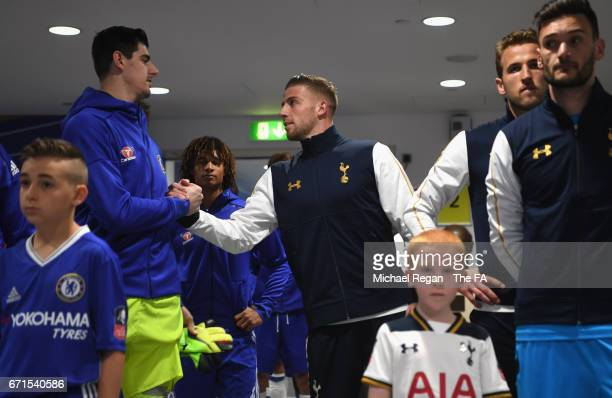 Belgian team mates Thibaut Courtois of Chelsea and Toby Alderweireld of Tottenham Hotspur shake hands during The Emirates FA Cup SemiFinal between...