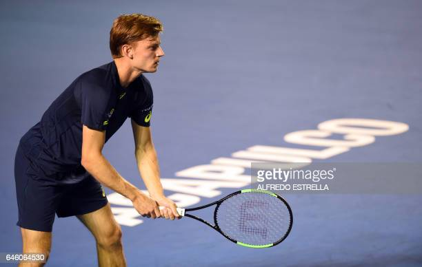 Belgian tennis player David Goffin awaits the return from French tennis player Stephane Robert on the first day of the Mexican Tennis Open in...