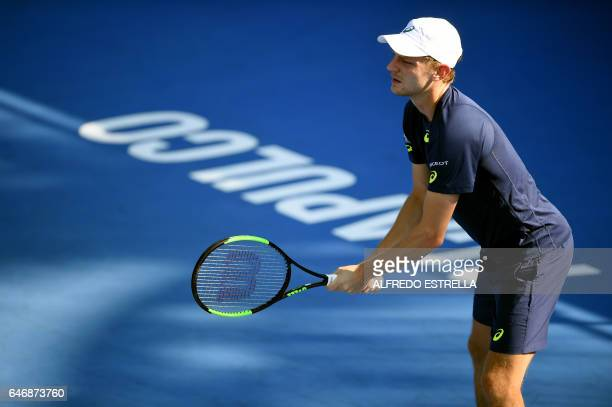 Belgian tennis player David Goffin awaits the serve from US player Sam Querrey during the third day of the Mexican Tennis Open in Acapulco Guerrero...