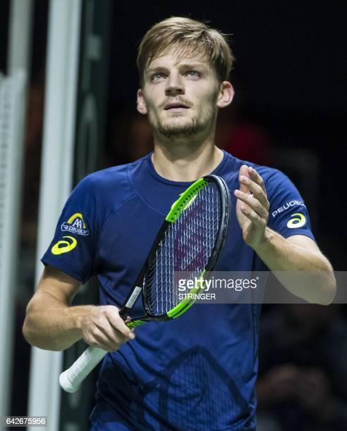 Belgian tennis player David Goffin prepares to returns a shot against French tennis player PierreHugues Herbert during the ABN Amro World Tennis...