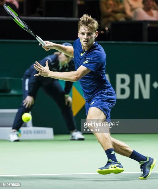 Belgian tennis player David Goffin returns a shoot against French tennis player PierreHugues Herbert during the ABN Amro World Tennis Tournament...