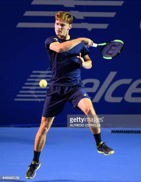 Belgian tennis player David Goffin returns against French Stephane Robert on the first day of the Mexican Tennis Open in Acapulco Guerrero State...