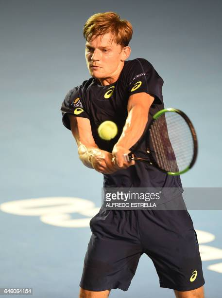 Belgian tennis player David Goffin returns the ball to French tennis player Stephane Robert on the first day of the Mexican Tennis Open in Acapulco...