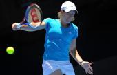 Belgian tennis player Justine Henin plays a backhand return during her women's singles quarterfinal match against Russian opponent Nadia Petrova on...