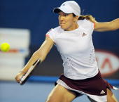 Belgian tennis player Justine Henin plays a backhand stroke during her womens singles match against Russian opponent Maria Sharapova at the...