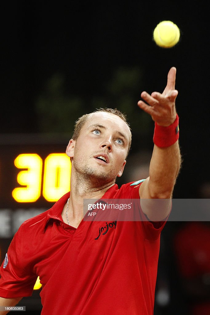 Belgian tennis player Steve Darcis serves during the match between Belgium's Steve Darcis and Israel's Amir Weintraub, the fifth match of the Davis Cup meeting between Belgium and Israel, on September 15, 2013 in Antwerp.