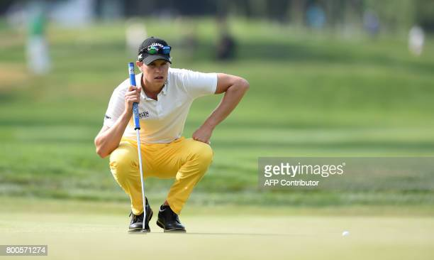 Belgian Thomas Detry eyes the ball during his match at the first final day of the BMW International Open golf tournament in Eichenried near Munich...