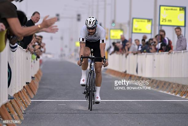 Belgian Tom Boonen of EtixxQuick Step team rides to win the silver jersey for the rider with the general point lead during the stage three individual...