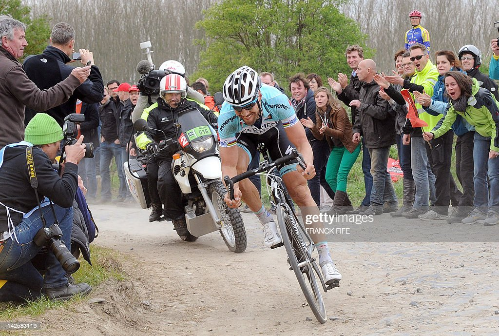 Belgian Tom Boonen of team Omega Pharma-Quick Step rides on the cobblestoned road during the 110th edition of the Paris-Roubaix cycling race between Compiegne and Roubaix on April 8, 2012, in Roubaix, northern France. Boonen won the race ahead of French Sebastien Turgot (Team Europcar) and Italian Alessandro Ballan (Team BMC). Bonnen, who had previously won in 2005, 2008 and 2009, equals the record of wins in Paris-Roubaix held by compatriot Roger De Vlaeminck.