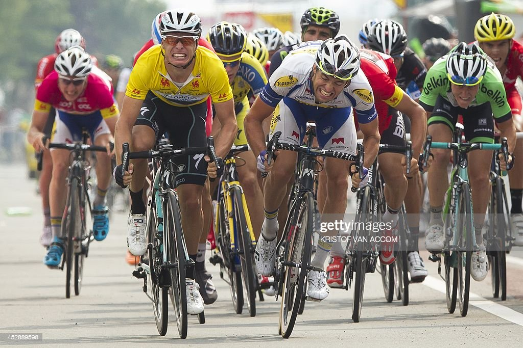 Belgian Tom Van Asbroeck of team Topsport Vlaanderen - Baloise (C) wins before Belgian Gianni Meersman of team Omega Pharma - Quick Step, wearing the yellow leader jersey (L) the sprint for the finish of stage 4 of the Tour De Wallonie cycling race, 174.9 km from Herve to Waremme, on July 29, 2014.