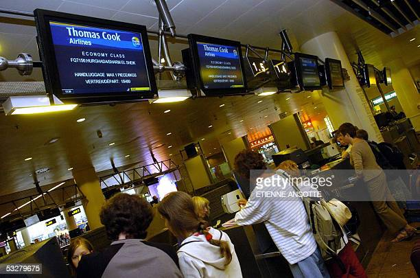 Belgian tourists check in prior to take off to Sharm el Sheik 24 July 2005 at Brussels national airport in Zaventem as the Red Sea resort was hit by...