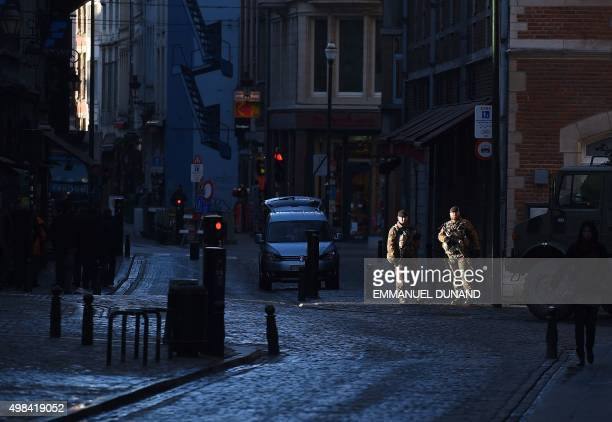 Belgian troops stand guard in Brussels on November 23 2015 as the Belgian capital remains on the highest possible alert level Brussels began a third...