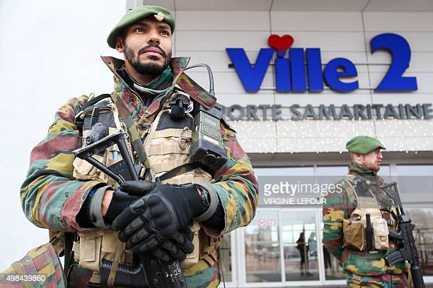 Belgian troops take position outside a commercial centre in Charleroi on November 23 2015 Brussels began a third consecutive day in lockdown under a...