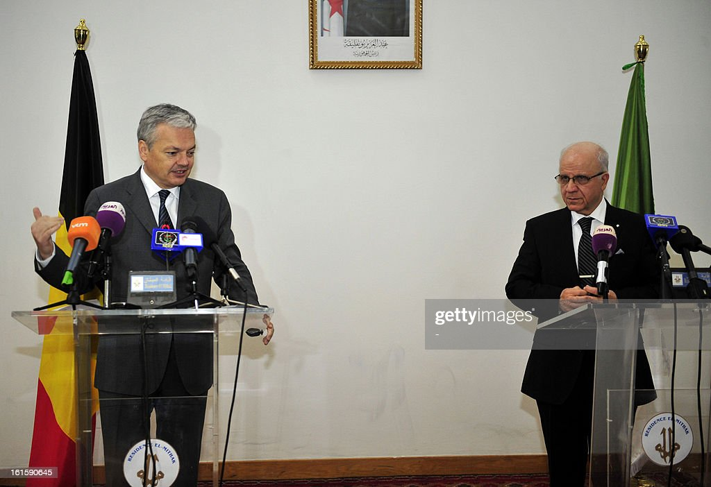 Belgian Vice-Prime minister and Foreign minister Didier Reynders (L) speaks during a joint press conference with Algerian Foreign Affairs Minister Mourad Medelci in the Algerian capitan on February 12, 2013.