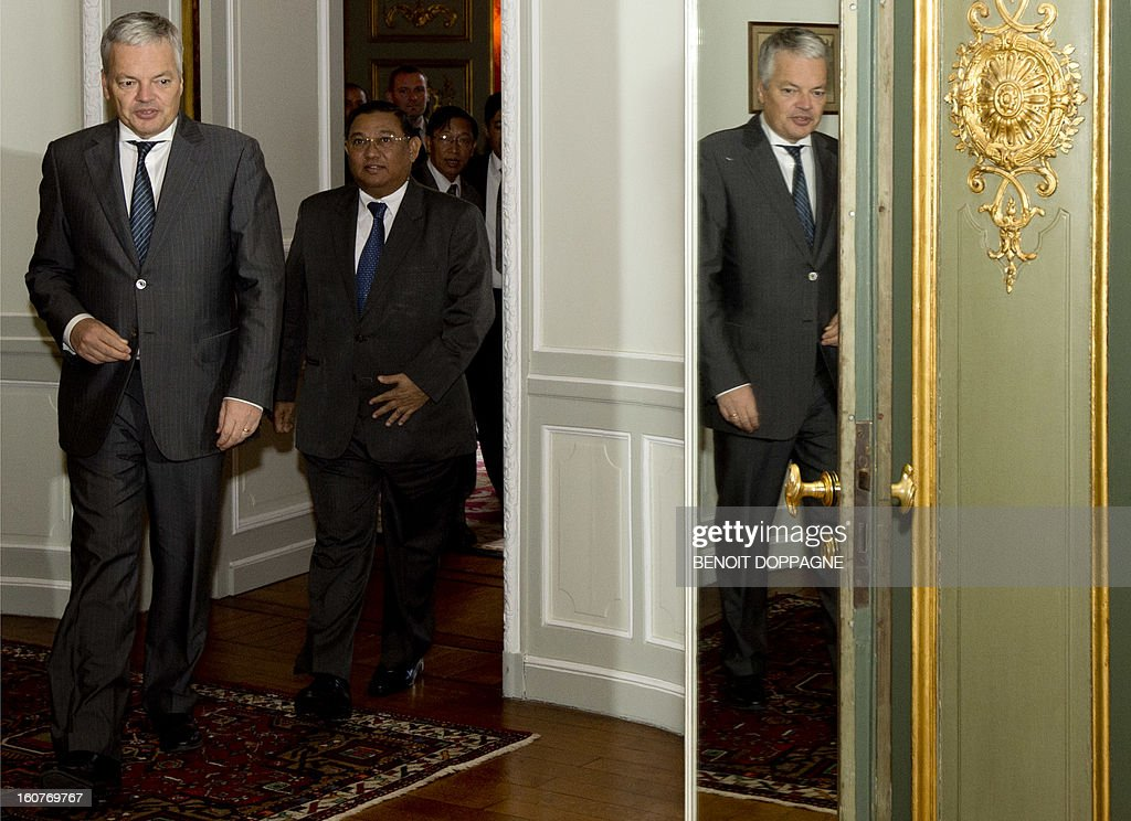 Belgian Vice-Prime minister and Foreign minister Didier Reynders (L) and Myanmar Foreign minister U Wunna Maung Lwin walk toward their meeting room at the Palais Egmont in Brussels, on February 5, 2013.