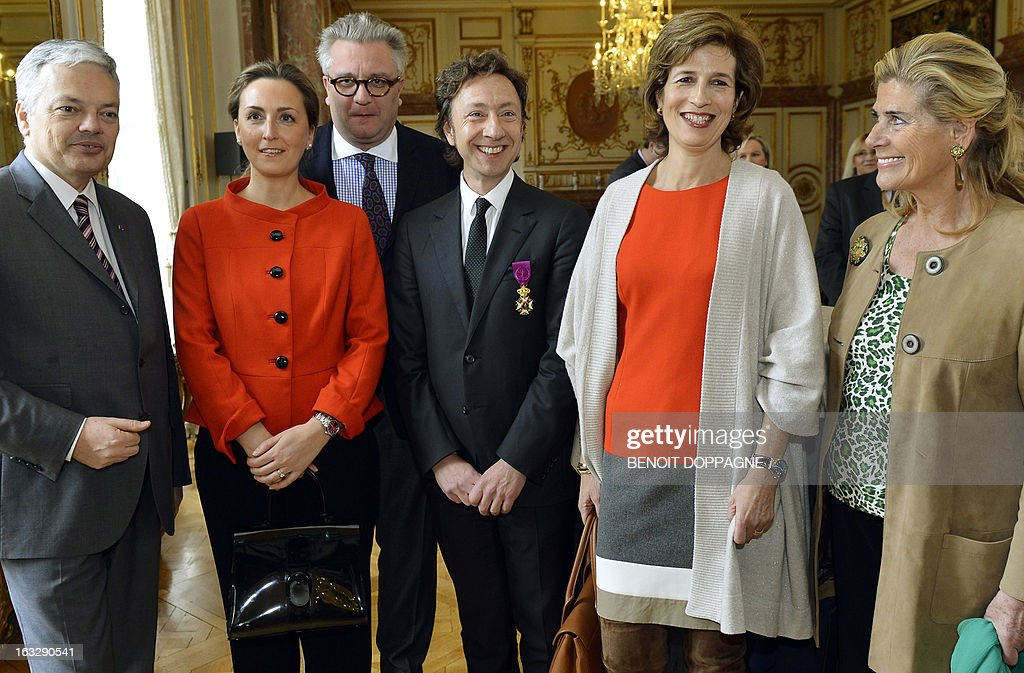 Belgian Vice-Prime Minister and Foreign Minister Didier Reynders, Princess Claire and Prince Laurent of Belgium, French journalist Stephane Bern, Belgium's Princess Marie Esmeralda and Belgium's Princess Lea attend a ceremony at the Egmont Palace in Brussels, on March 7, 2013. Bern was declared an Officer in the Order of Leopold, a Belgian national honourary order of knighthood, during the ceremony. Belgium Out