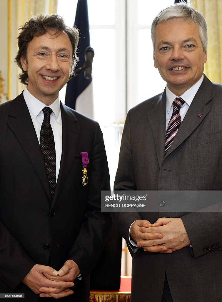 Belgian Vice-Prime Minister and Foreign Minister Didier Reynders (R) and French journalist Stephane Bern attend a ceremony at the Egmont Palace in Brussels, on March 7, 2013. Bern was declared an Officer in the Order of Leopold, a Belgian national honourary order of knighthood, during the ceremony. Belgium Out
