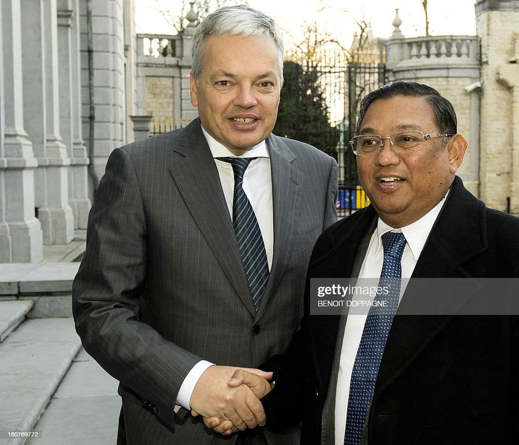 Belgian Vice-Prime minister and Foreign minister Didier Reynders (L) shakes hands with Myanmar Foreign minister U Wunna Maung Lwin prior to a meeting at the Palais Egmont in Brussels, on February 5, 2013.