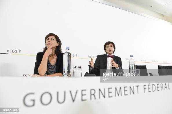 Belgian vicePrime Minister and Interior Minister Joelle Milquet and Belgian Prime Minister Elio Di Rupo give a press conference following a cabinet...