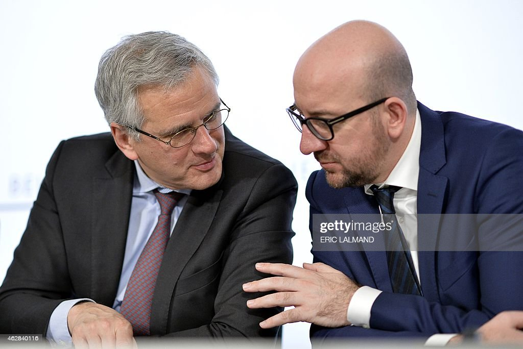 Belgian Vice-Prime Minister and Minister of Employment, Economy and Consumer Affairs <a gi-track='captionPersonalityLinkClicked' href=/galleries/search?phrase=Kris+Peeters&family=editorial&specificpeople=2203934 ng-click='$event.stopPropagation()'>Kris Peeters</a> (L) speaks with Belgian Prime Minister <a gi-track='captionPersonalityLinkClicked' href=/galleries/search?phrase=Charles+Michel+-+Politician&family=editorial&specificpeople=13722663 ng-click='$event.stopPropagation()'>Charles Michel</a> during a press conference after a ministers council in Brussels, on February 6, 2015.