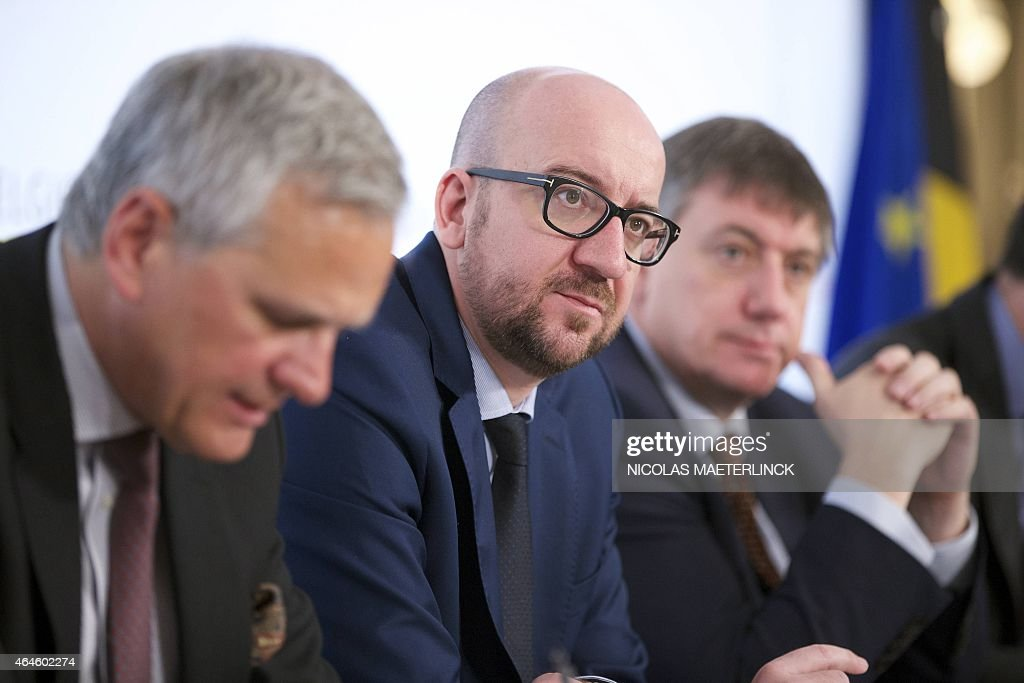 Belgian Vice-Prime Minister and Minister of Employment, Economy and Consumer Affairs <a gi-track='captionPersonalityLinkClicked' href=/galleries/search?phrase=Kris+Peeters&family=editorial&specificpeople=2203934 ng-click='$event.stopPropagation()'>Kris Peeters</a>, Belgian Prime Minister <a gi-track='captionPersonalityLinkClicked' href=/galleries/search?phrase=Charles+Michel+-+Politician&family=editorial&specificpeople=13722663 ng-click='$event.stopPropagation()'>Charles Michel</a> and Belgian Vice-Prime Minister and Interior Minister Jan Jambon give a press conference after a Minister's council meeting of the federal government in Brussels on February 27, 2015. AFP PHOTO / BELGA PHOTO / NICOLAS MAETERLINCK