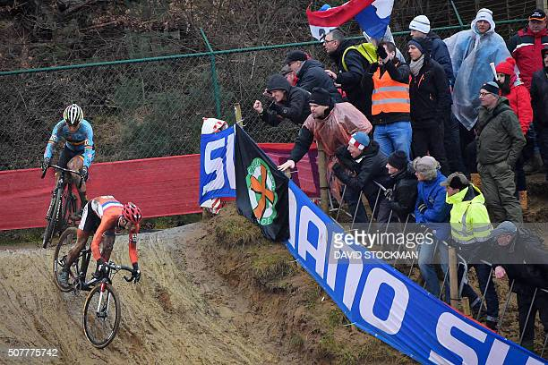 Belgian Wout Van Aert and Dutch Lars Van Der Haar compete in the men's elites race at the world championships cyclocross cycling in HeusdenZolder on...