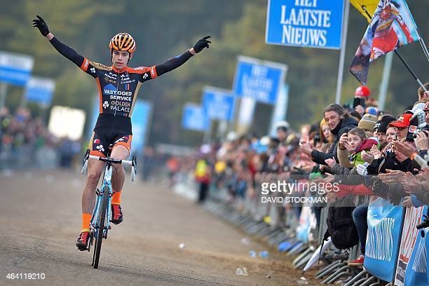 Belgian Wout Van Aert celebrates as he crosses the finish line to win the Internationale Sluitingsprijs Oostmalle cyclocross race on February 22 in...