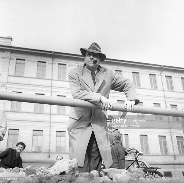 Belgian writer Georges Simenon leaning on a railing Milan 1957