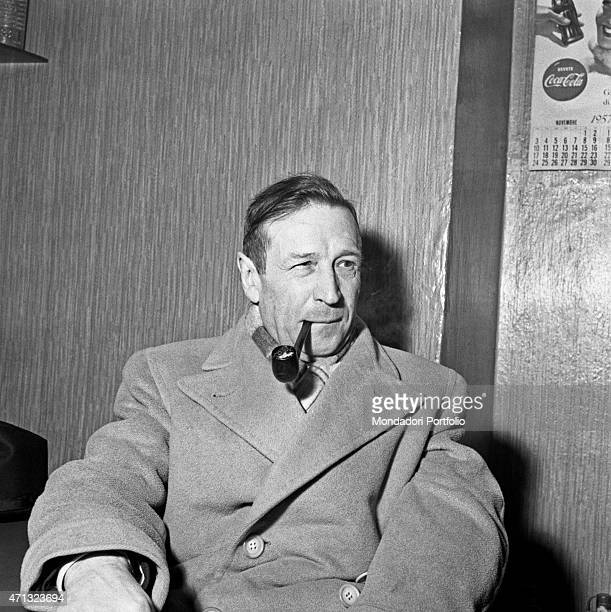 Belgian writer Georges Simenon smoking the pipe Milan 1957