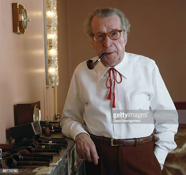 Belgian writer Georges Simenon with some of his pipes May 1984