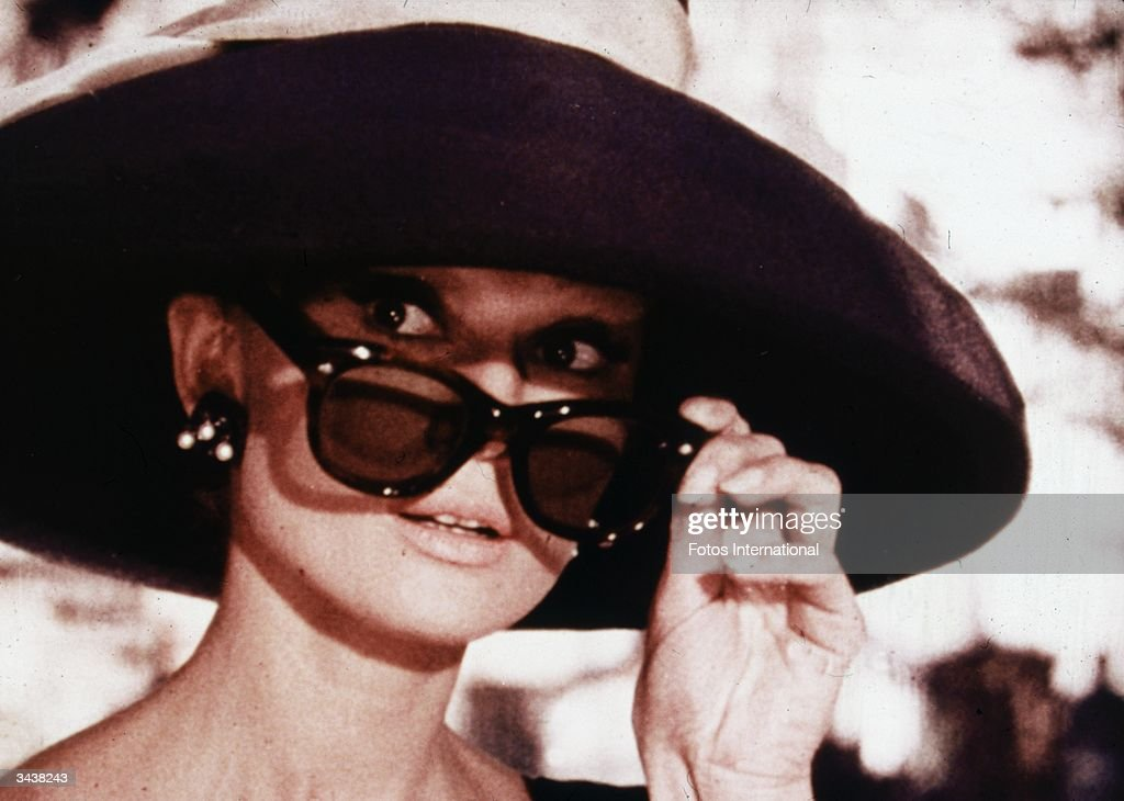 Belgianborn actor Audrey Hepburn lowers her sunglasses in a still from director Blake Edwards' film 'Breakfast at Tiffany's'