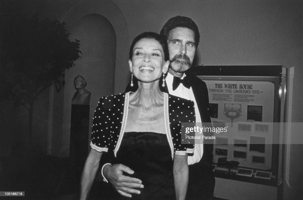 Belgian-born actress Audrey Hepburn (1929 - 1993) and her partner, Dutch actor Robert Wolders, arriving at a White House dinner, Washington DC, 1989.