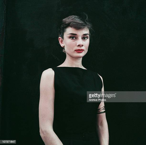 Belgianborn actress Audrey Hepburn in a black sleeveless dress circa 1955