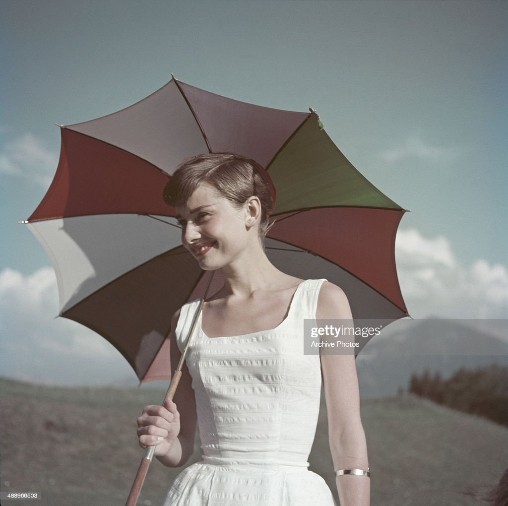 Actress <a gi-track='captionPersonalityLinkClicked' href=/galleries/search?phrase=Audrey+Hepburn&family=editorial&specificpeople=86470 ng-click='$event.stopPropagation()'>Audrey Hepburn</a> (1929 - 1993) with an umbrella, circa 1955.