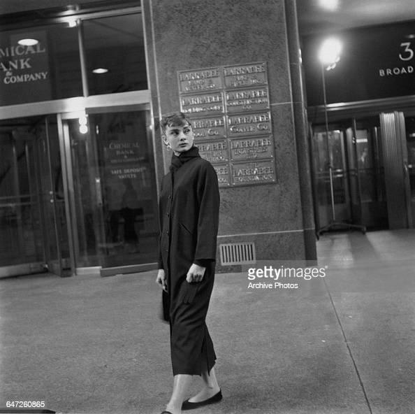 Belgianborn actress Audrey Hepburn on the set of director Billy Wilder's film 'Sabrina' New York October 1953 She is standing outside 30 Broad Street...