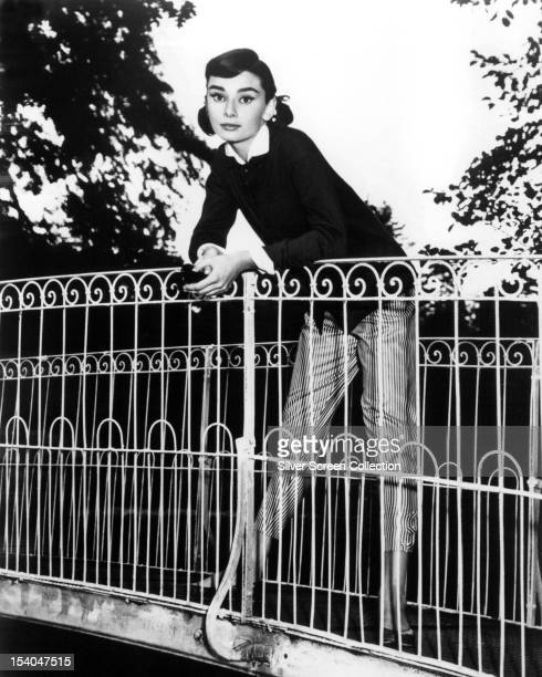 Belgianborn actress Audrey Hepburn posing on a bridge circa 1953