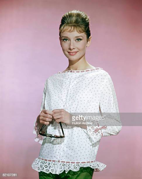 Belgianborn American actress Audrey Hepburn wearing a white blouse with pink flowers circa 1963